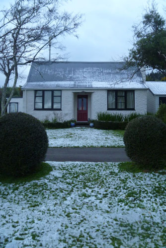 Snow fall on historic cottage